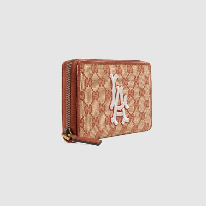 1db06afe6901 Gucci Canvas Wallet - ShopStyle UK