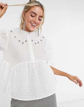 Sister Jane Dream relaxed top with embellished collar and peplum hem in textured fabric