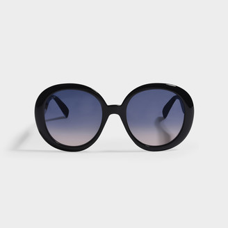 Gucci Black Round Sunglasses In Injection