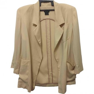 Gucci Gold Wool Trench coats