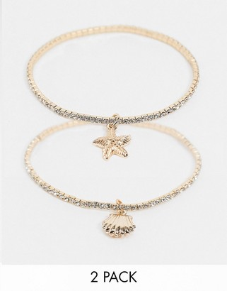 ASOS DESIGN pack of 2 stretch bracelets with aquatic charms in gold tone