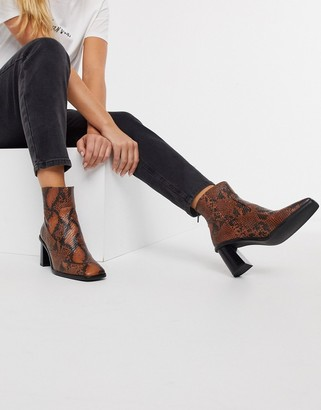 Schuh Bobby heeled ankle boots in black snake print leather