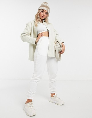 NA-KD faux-leather jacket in cream