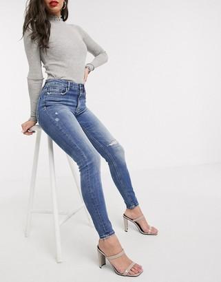 Stradivarius super high waist skinny jeans in with rip in medium blue