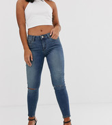 Asos DESIGN Petite Lisbon mid rise skinny jeans in extreme dark stonewash with knee rips