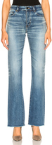 Saint Laurent Cropped Flare Jeans in Blue.