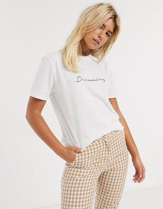 Asos DESIGN t-shirt with dreaming slogan in organic cotton
