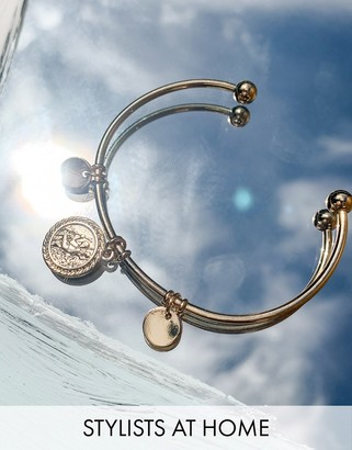 ASOS DESIGN cuff bracelet with coin charms in gold tone