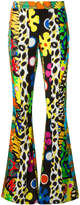 Moschino multi print flared trousers