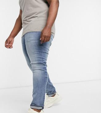ASOS DESIGN Plus 'Enhanced Stretch' Skinny jean in mid wash