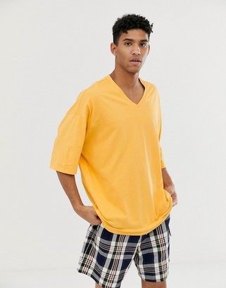 Asos Design DESIGN oversized hockey t-shirt in yellow