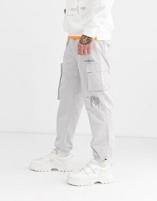 Taka Original nylon utility joggers with print and neon draw cords-Grey