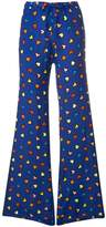 Love Moschino heart print flared trousers