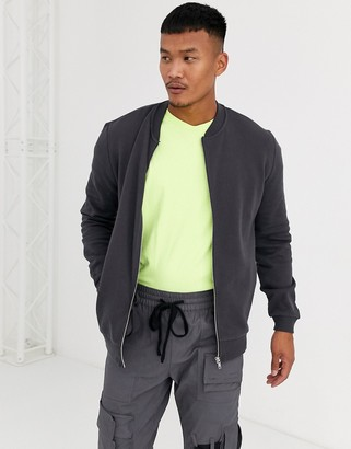 ASOS DESIGN jersey bomber jacket in washed black