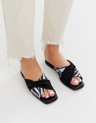 Asos Wallflower leather bow detail flat sandals in black and zebra