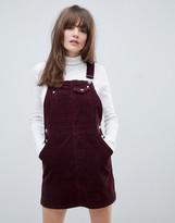 Asos Design DESIGN cord dungaree dress in oxblood