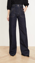 Marc Jacobs Runway Flared Jeans With Braided Waist & Pocket