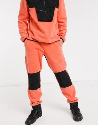 ASOS DESIGN co-ord tapered joggers in polar fleece with nylon panels in coral
