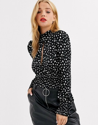 ASOS DESIGN keyhole top in slinky with shirred cuff and tie back in spot print