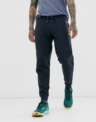 Asos Design DESIGN tapered joggers with silver zips in navy