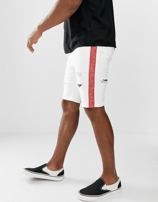 ASOS DESIGN skinny denim short in white with rips and red side stripe