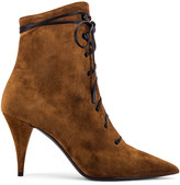 Saint Laurent Kiki Lace Up Ankle Booties in Land | FWRD