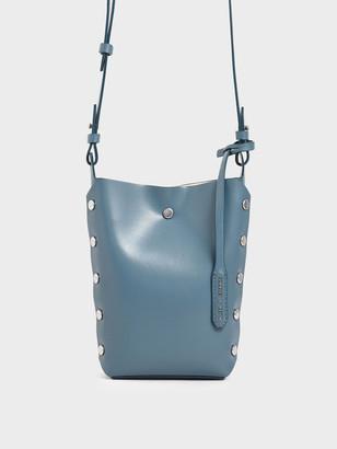 Charles & Keith Mini Reversible Studded Crossbody Bag