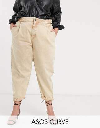 Asos DESIGN Curve Tapered boyfriend jeans with D-ring waist detail with curved seams in washed lemon