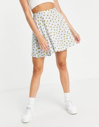 Monki Malina organic cotton mini skater skirt in blue sunflower