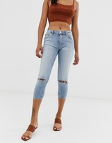 Asos DESIGN Lisbon mid rise cropped skinny jeans in mid stone wash with ripped knees