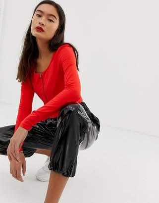 Noisy May zip through cropped top-Red