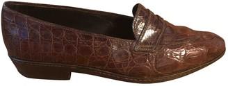 Prada Brown Crocodile Flats
