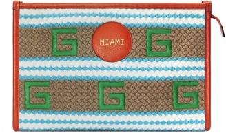 Gucci Miami striped pouch