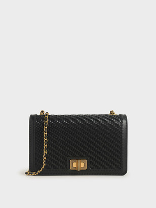 Charles & Keith Woven Turn-Lock Clutch