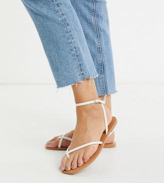 ASOS DESIGN Wide Fit Farnborough minimal toe loop flat sandals in white