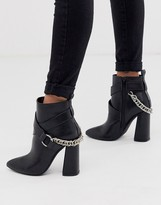 Co Wren pointed block heel boots with chain