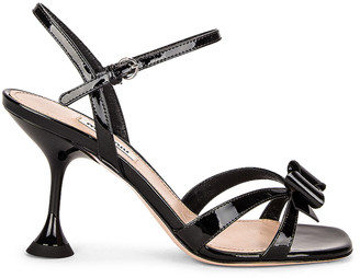 Miu Miu Patent Leather Sandals in Nero | FWRD