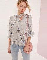 Girls On Film Cross Front Bow Blouse