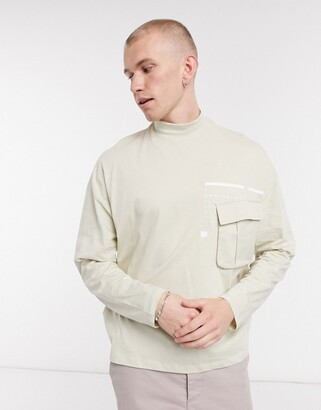 Asos Unrvlld Supply ASOS Unrvlld Spply oversized turtle neck long sleeve t-shirt with utility pocket
