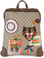 Gucci Embroidered badge drawstring backpack