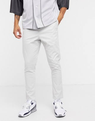 ASOS DESIGN tapered chinos with elastic waist in ice gray