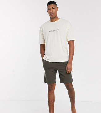 Asos DESIGN Tall lounge pyjama set with oversized tshirt and short in stone with authentique slogan