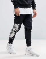 Criminal Damage Skinny Joggers In Black With Baroque Print