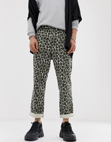 Asos DESIGN relaxed fatigue pants in washed animal print