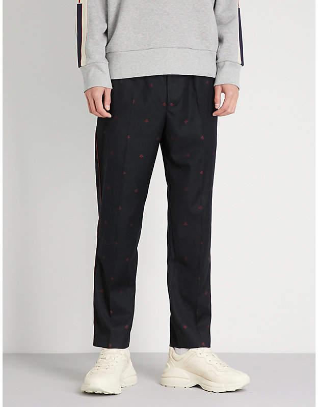 Gucci Bee-print straight wool-gabardine trousers