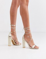 Glamorous gold block heeled sandals with ankle tie