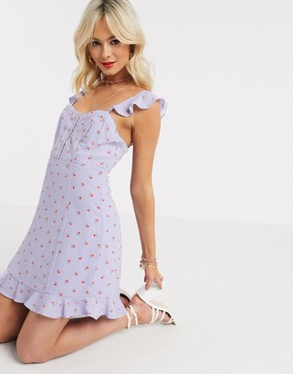 Gilli mini dress with ruffle hem and strap detail in lilac ditsy floral