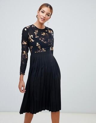 Little Mistress foil print mini dress with pleated skirt in black multi