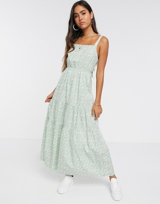 Vero Moda tiered floral maxi dress with tie back detail in green daisy print