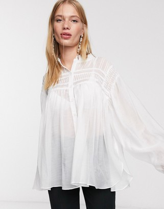 GHOSPELL oversized shirt with statement sleeves and pleated detail